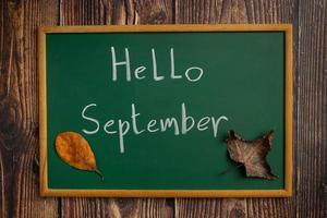 writing board hello september photo