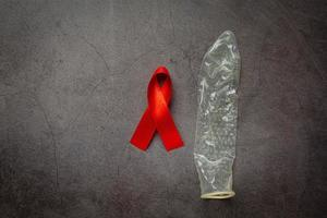 red ribbon and condom world health day concept photo