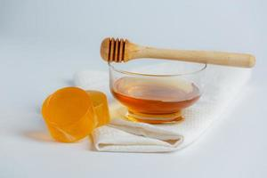 jabón y suero natural para el cuidado de la piel con miel y panal de abeja foto