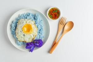 delicious breakfast scrambled eggs in white plate and clean photo