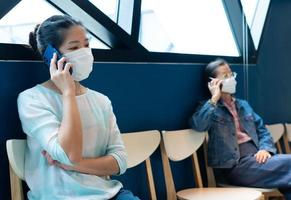 people wearing face mask and keep social distancing in restaurant photo