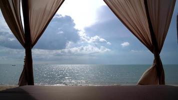 Beautiful curtain in pavilion with sea beach background video
