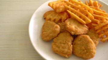 Fried chicken nuggets with fried potatoes video