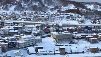 Vue sur la ville d'otaru avec de la neige à Hokkaido, Japon video