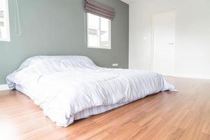Bed decoration in bedroom interior - Vintage Light Filter photo