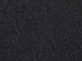 Dark concrete texture wall background. Black grunge cement wall. photo
