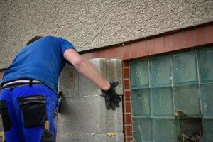 The traditional domestic way of wall masonry using concrete blocks photo