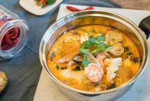 Sour seafood soup or Tom Yum Seafood photo
