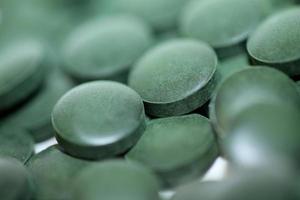 Pills close up medical spirulina platensis algae family algaespace photo