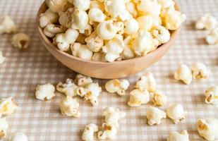 Caramel popcorn in bowl on the table photo