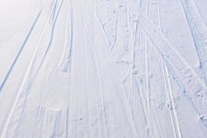 ski trail in the white and blue snow on mountain surface photo