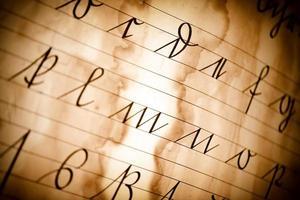 Vintage old Latin Alphabets on Paper Background photo