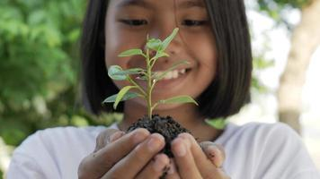 Girl Holding a Little Green Plant in Her Hand video