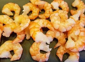 some fresh spiced and roasted shrimps photo