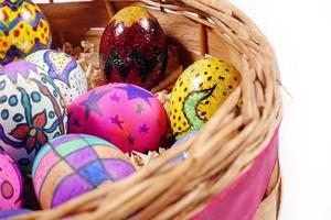Colorful Easter Eggs in a Wooden Basket photo