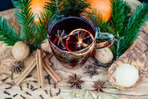 mulled wine and christmas spices on olive wood photo