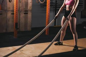 woman working out in training gym doing cross fit exercise photo