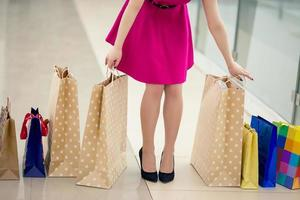 close up woman walking with shopping bags photo