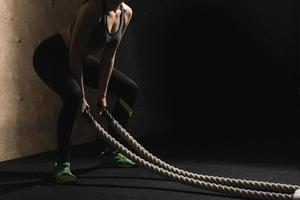 battling ropes girl at gym workout exercise fitted body photo