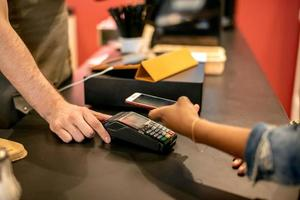 Customer paying with NFC technology with smart watch photo