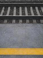 Yellow stripe on a railway passenger platform. photo