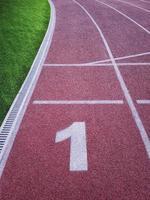 First running track in stadium. photo