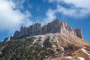 Dolomite rocks with snow remnants in the dry season. photo