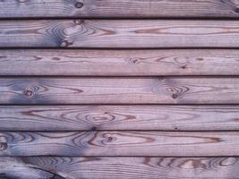 Horizontal wooden rough planks background. photo