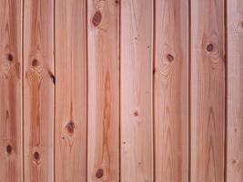 Low-grade vertical wood panels with rough surface finish. photo