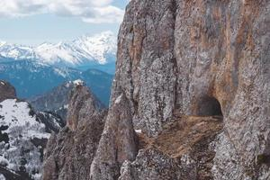 Wild mountain goat cave among the sharp-pointed rocks. photo