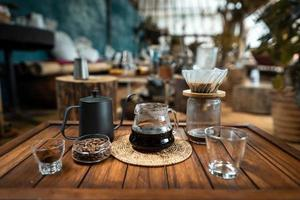 drip coffee on a wooden table at home photo