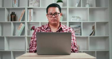 Man Working with Laptop Computer at Home video
