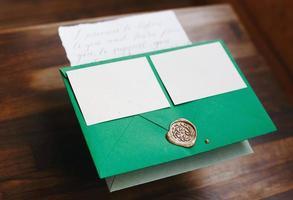 Wedding details flat lay. Wedding invitation. Mock up. Envelope. photo