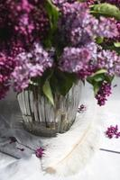 Bouquet of violet lilac in a vase. Still life with branches of lilac. photo