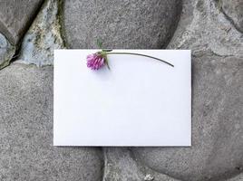 Wedding details flat lay on stone background. Wedding invitation. photo