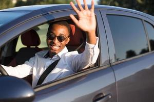 happy african american driving welcomes, in the summer photo
