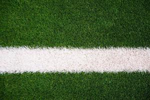 Photo of green grass and white line on football stadium