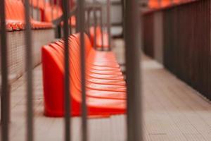 Selective focus of orange chairs on stadium, no people photo