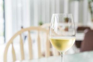 A glass of sparking wine in restaurant photo