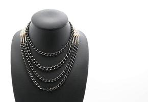 Beautiful and luxury necklace with jewelry stand neck on white photo