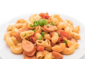 Macaroni with sausage on white background photo