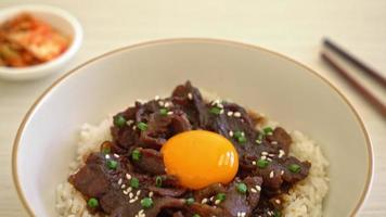 Rice with soy flavored pork or Japanese pork donburi video