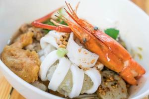 Asian seafood spicy noodle soup photo