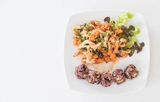 Spicy vegan salad with sticky berry and grain rice photo