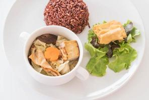 Stuffed cabbage soup with berry rice and tofu photo