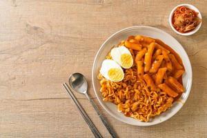 Ramen or Korean instant noodle and Tteokbokki in spicy korean sauce photo