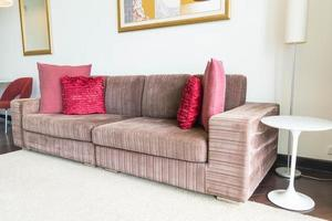 Beautiful pillow on sofa decoration in living room photo