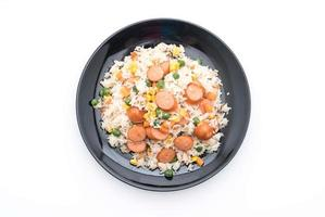 Fried rice with sausage on white background photo
