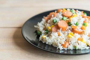 Fried rice with sausage on the table photo