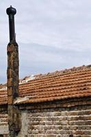 Abstract Vintage Brick Stone Made House Chimney photo